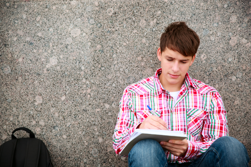 teen with notebook, selective focus on face